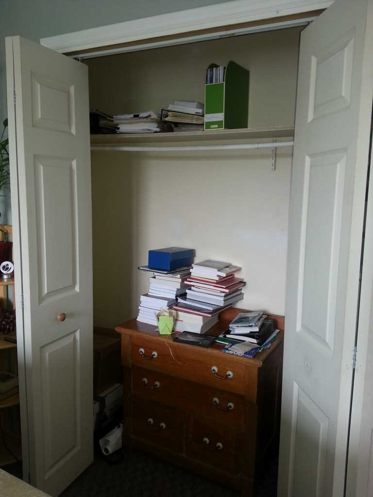Gasp!  Residue from the broken bookcase.  Also a pile or two of filing on the upper shelf.